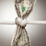 Wrinkled American Dollar Tied Up in Rope.